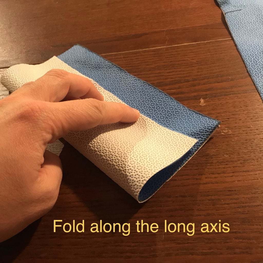 Fold Along Long Axis and Secure With Clips