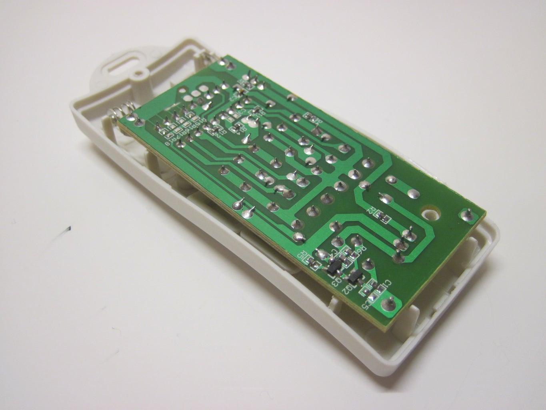 Open the Remote and Remove the Circuit Board