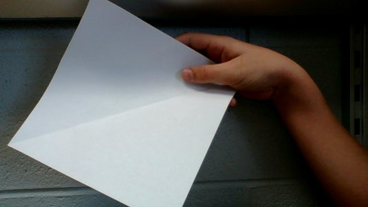 Fold One Corner of the Paper to the Corner on the Opposite Side.