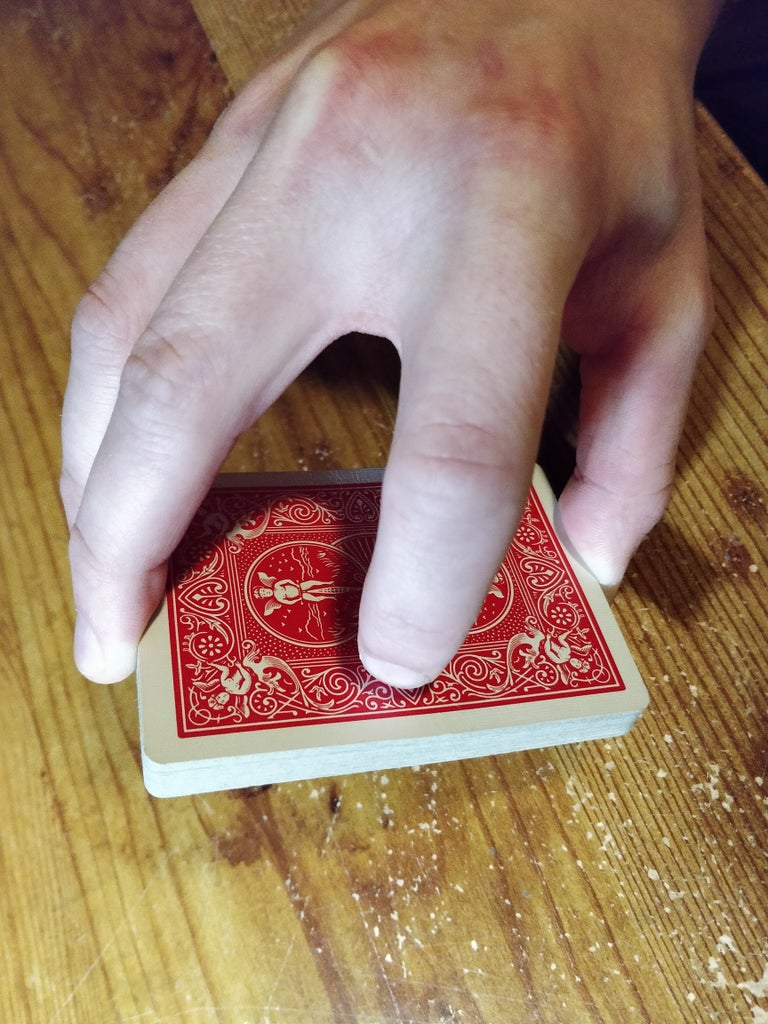 Pick Up About Half of the Cards in Each Hand Using the Grip Shown.