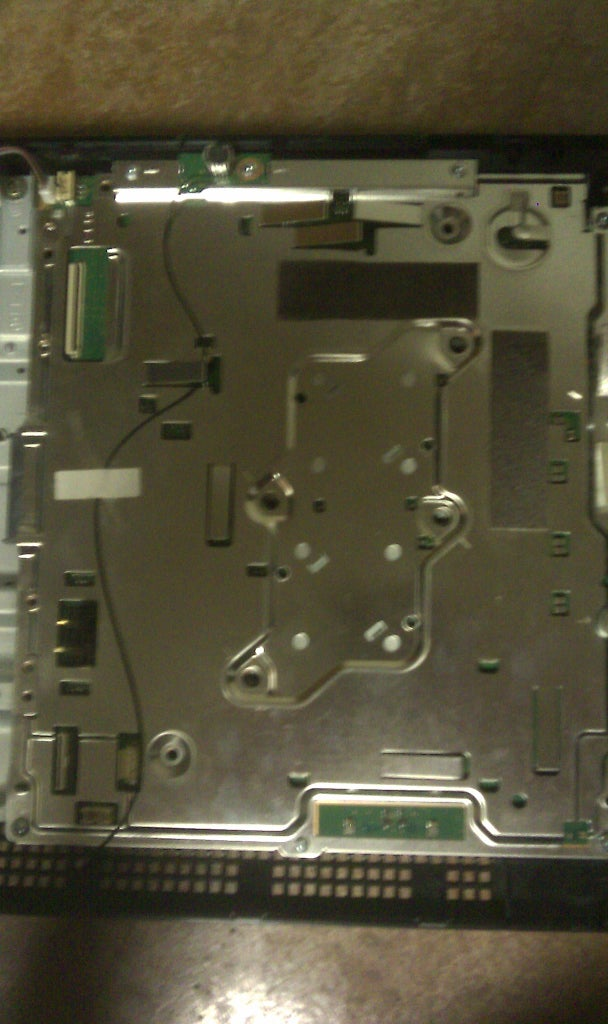 Detaching the Large Metal Plate