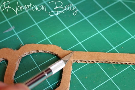 Score the Glasses at the Hinges, So That It Bends at the Angle to Fit Your Child's Face.