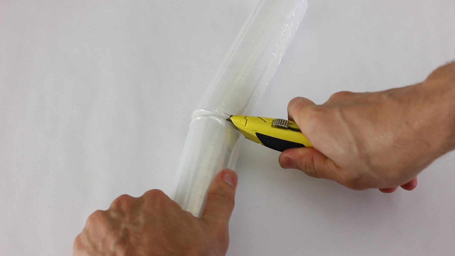 Cut the Roll of Plastic Wrap to the Desired Width (optional)