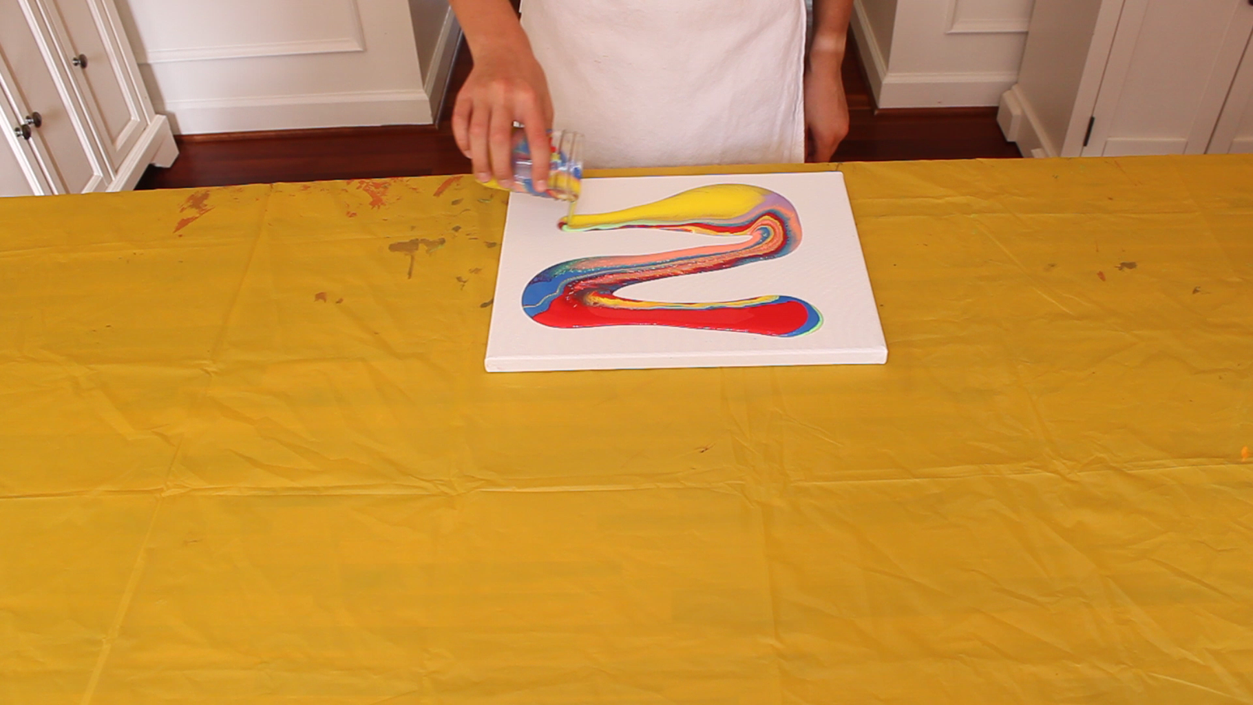 Pouring the Paint on the Canvas
