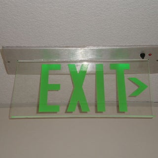 800px-Glass_exit_sign_with_green_text.JPG