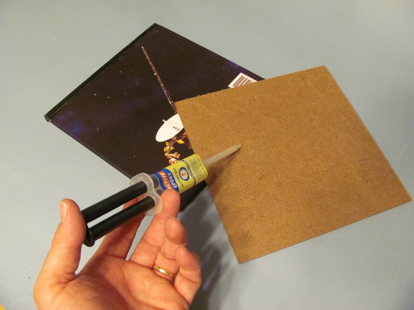 Glue the Hard Board to the Back of the Book
