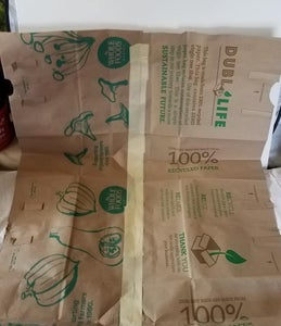 Cut Two Paper Grocery Bags Completely Open and Join Together With Masking Tape