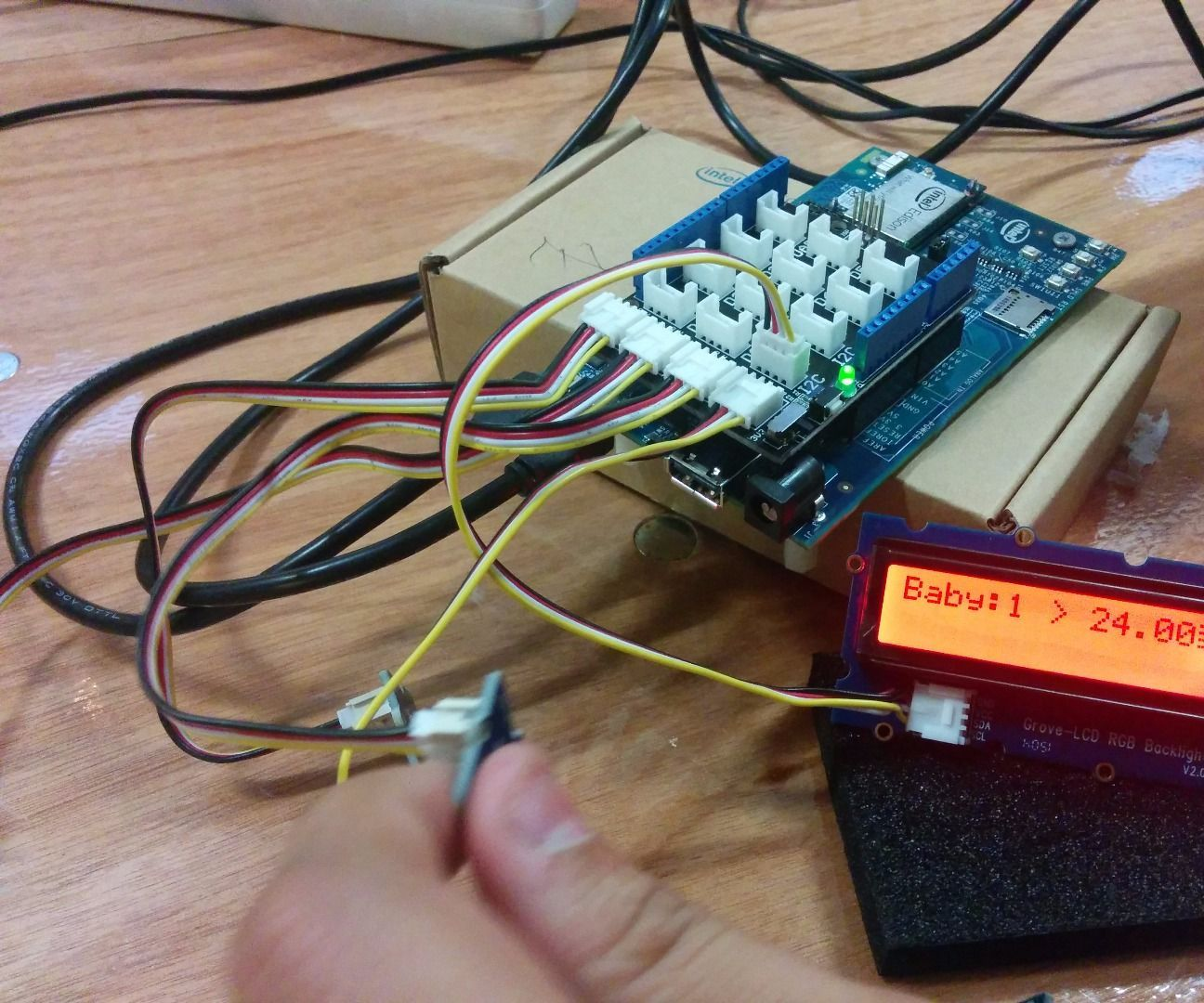 Newborns monitoring system (Based on wearable temperature sensors and Intel's Edison)