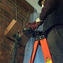 Dust minimizing vacuum cleaner shroud for hammer drilling indoors