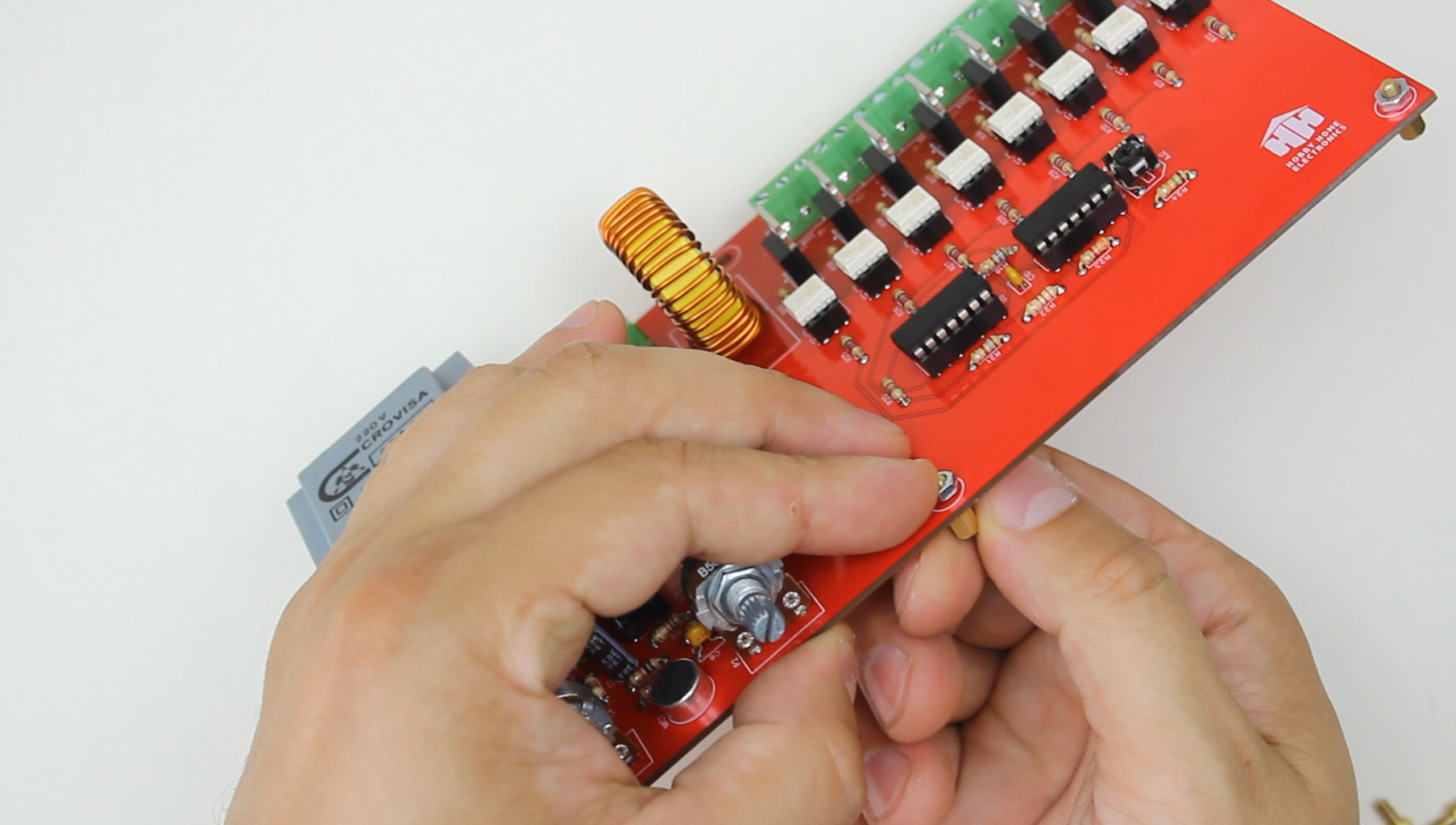 Assembly of the Control Circuit Board With the Bottom Panel.