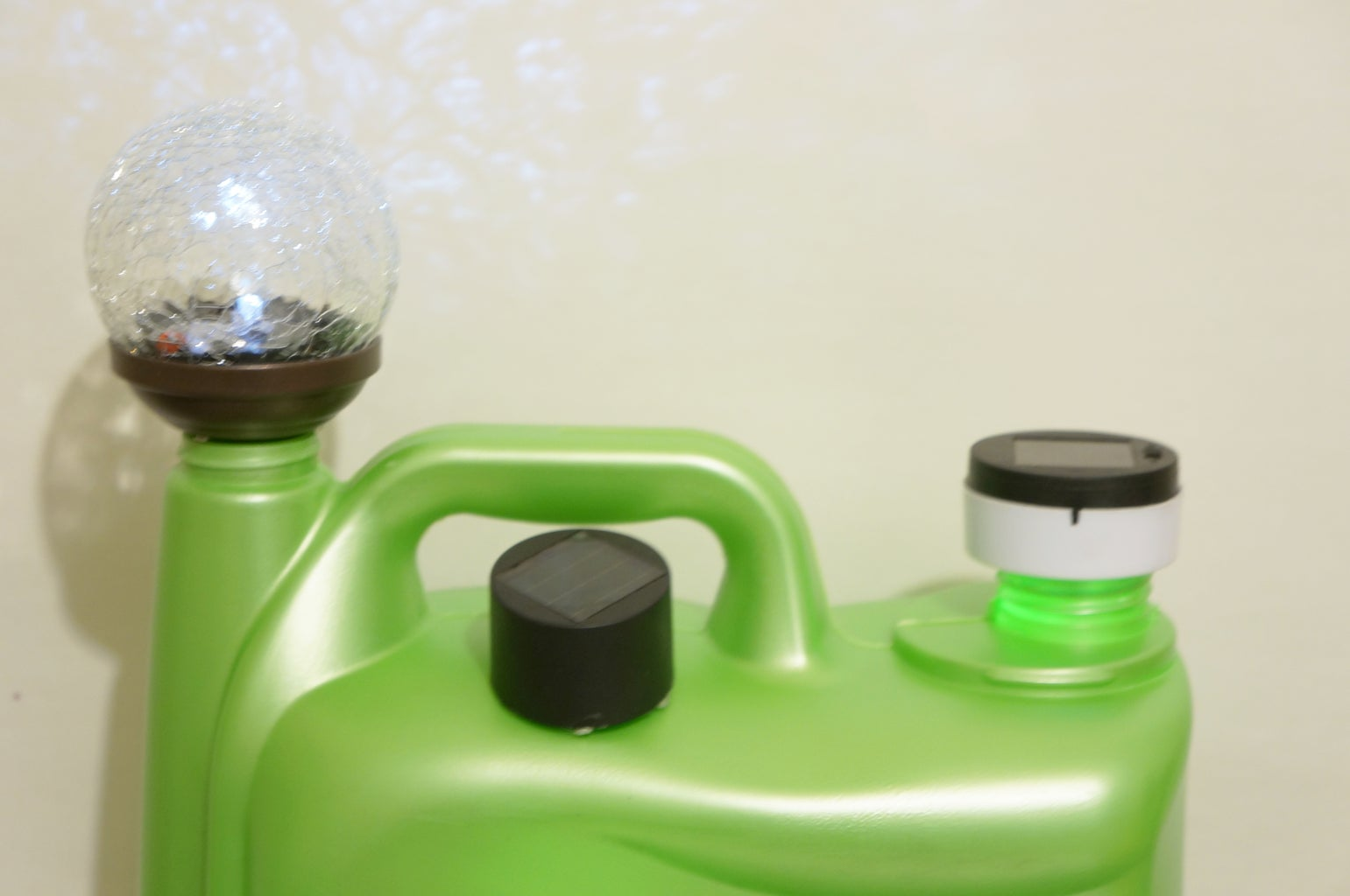 Drill and Glue the Solar Lights to the Jug