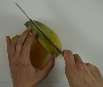 Prepare Your Mango, Find the Pit, and Cut It Out.