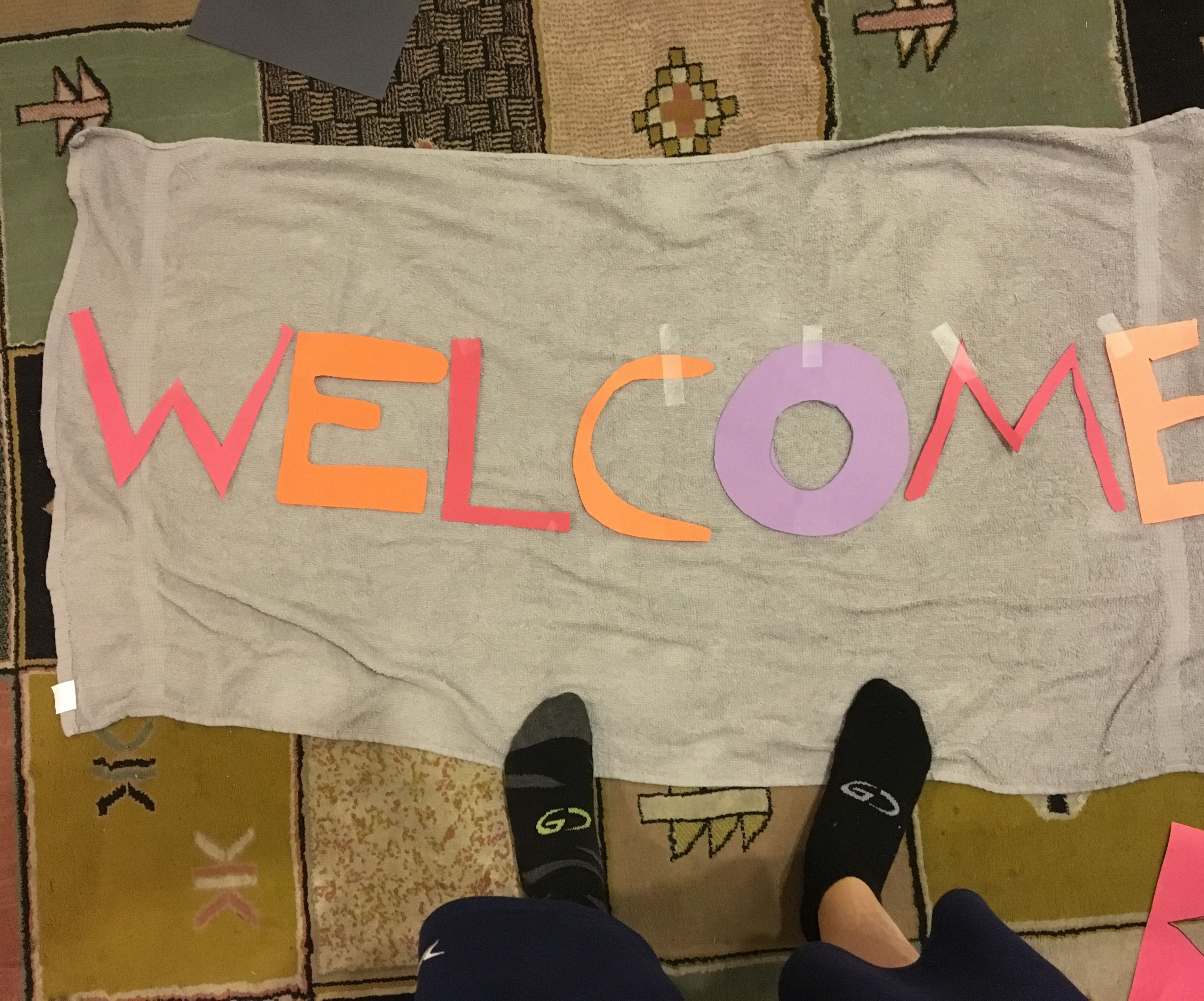 Make a Welcome Rug out of an old towel