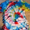 How To Turn Your Old T-Shirt Into A Fashionable Top! (sides knotted or slitted)