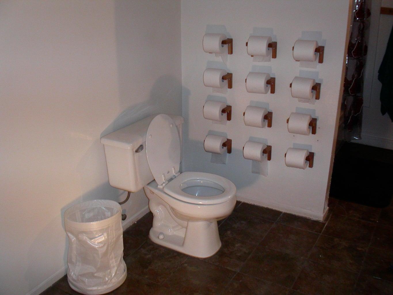 Install Twelve Toilet Paper Holders