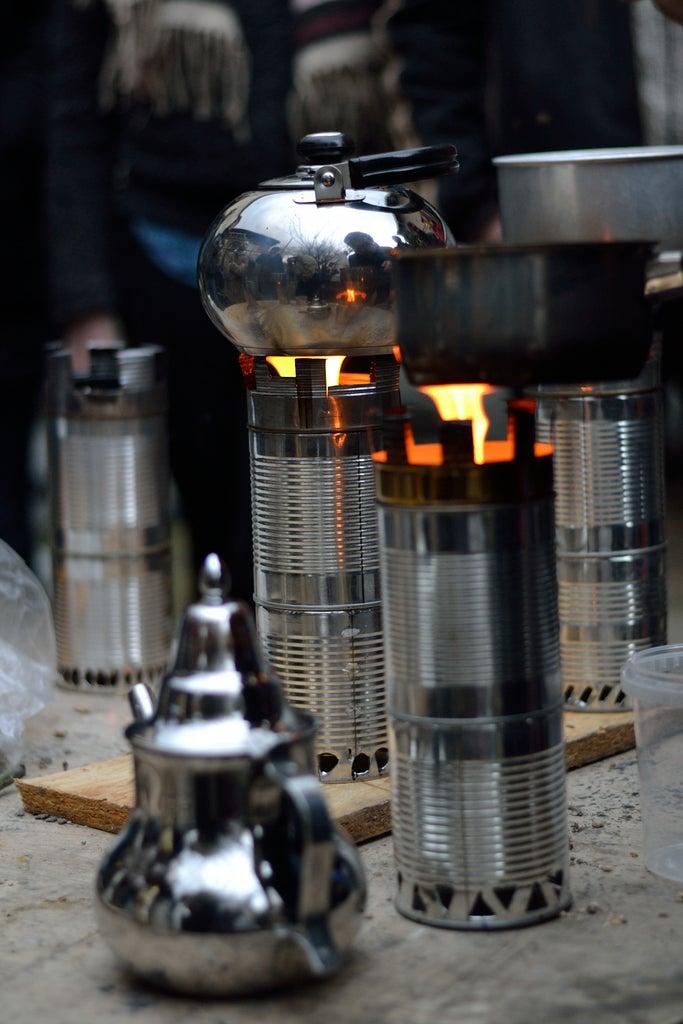 Pyrocan - Cuiseur Biomasse En Boites De Conserve