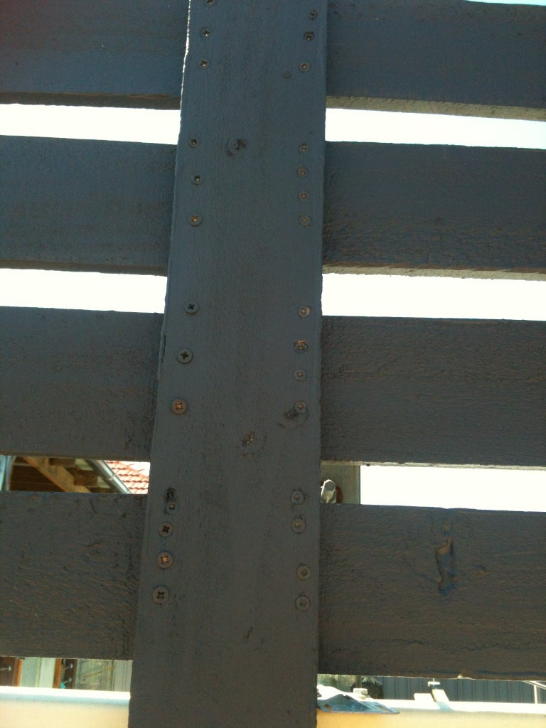 Attached Completed Panels to Support Rails