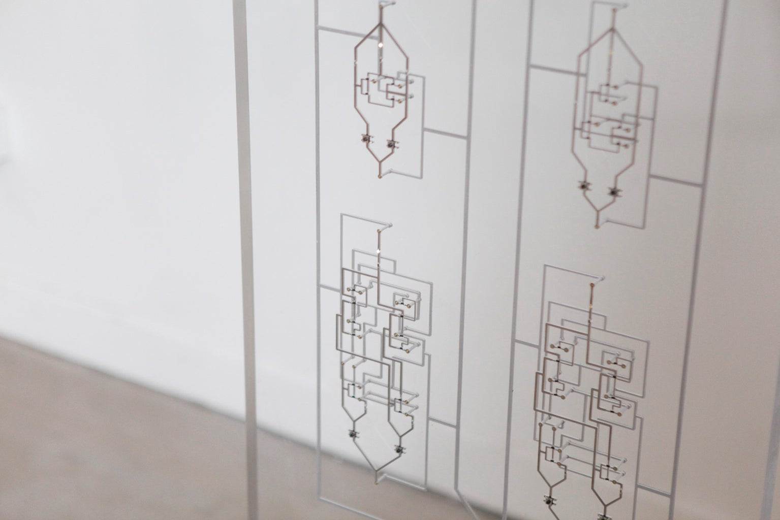 Inlaid Logic : a Giant Circuit Board Inlay Made Out of Waterjet Electronic Traces