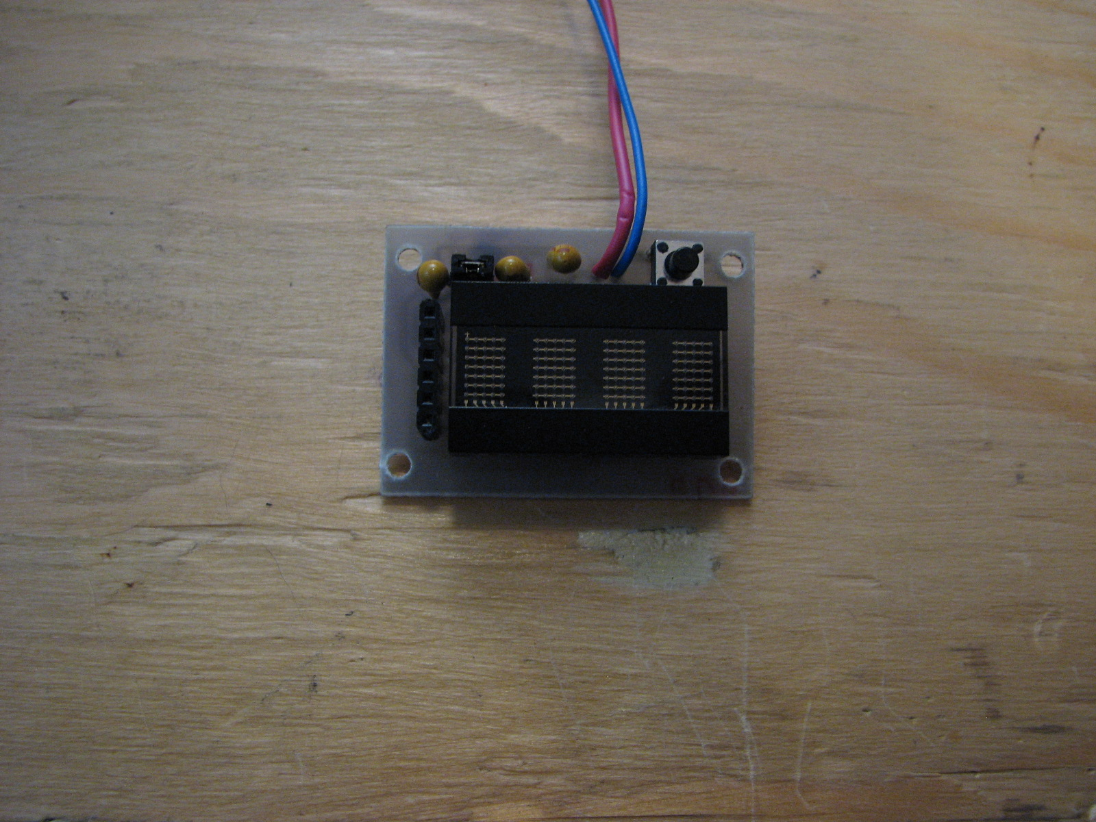 Programmable watch with four character display