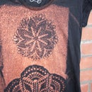 Dye a shirt with bleach and a doily