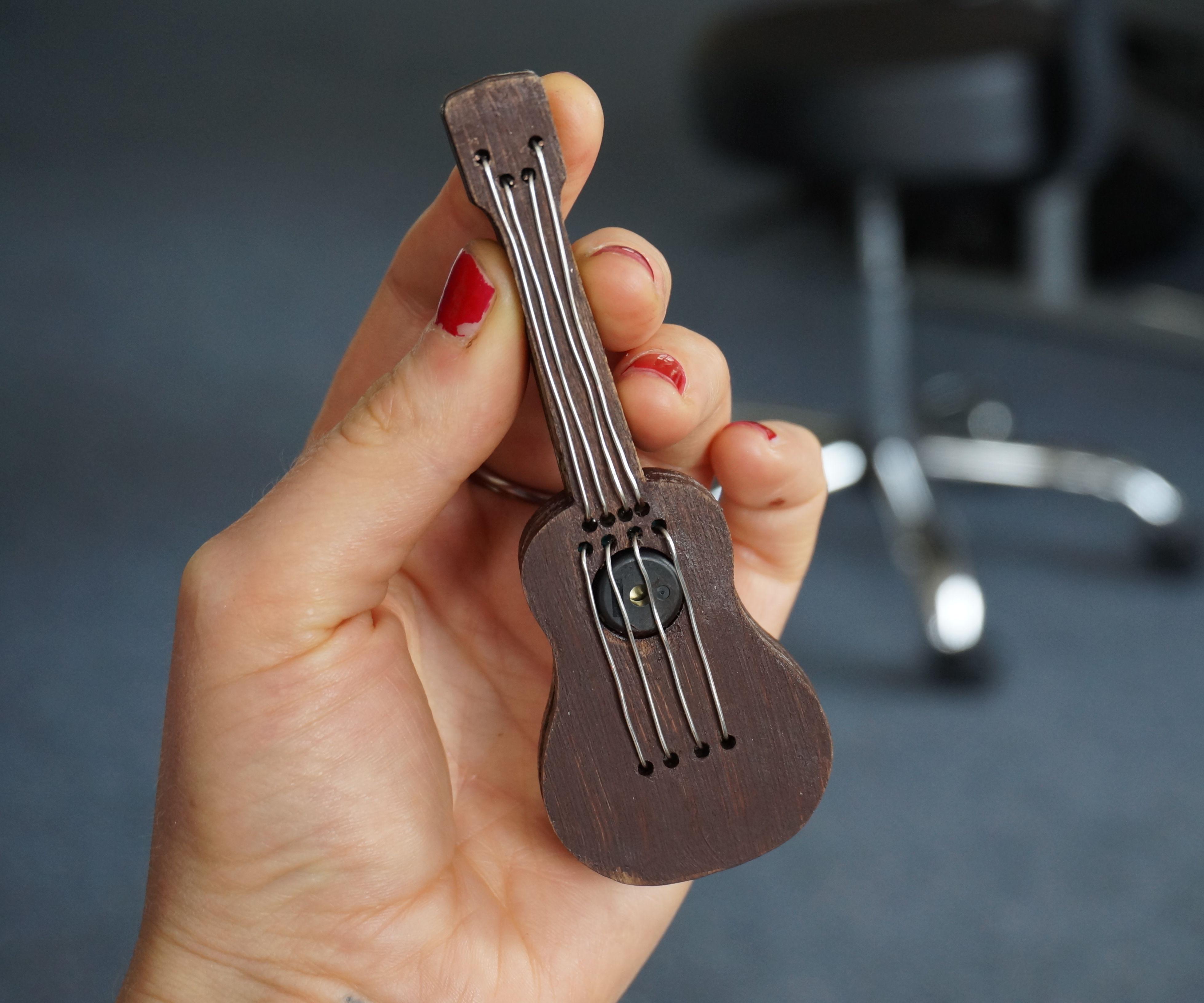 Tiny electric ukulele