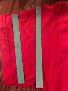 (Optional) Adhere Two Small Strips of Paper to Each of the Sleeves As Shown