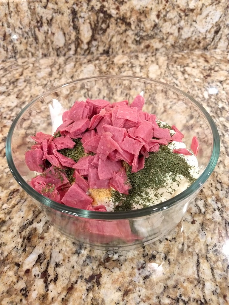 Add Your Chopped Up Pieces of Corned Beef to Your Sour Cream, Mayo, Parsley Flakes, Dill Weed and Lawry's.