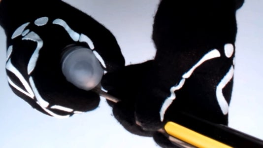 With the Help of a Screwdriver Blade, Remove the Ball Deodorant.
