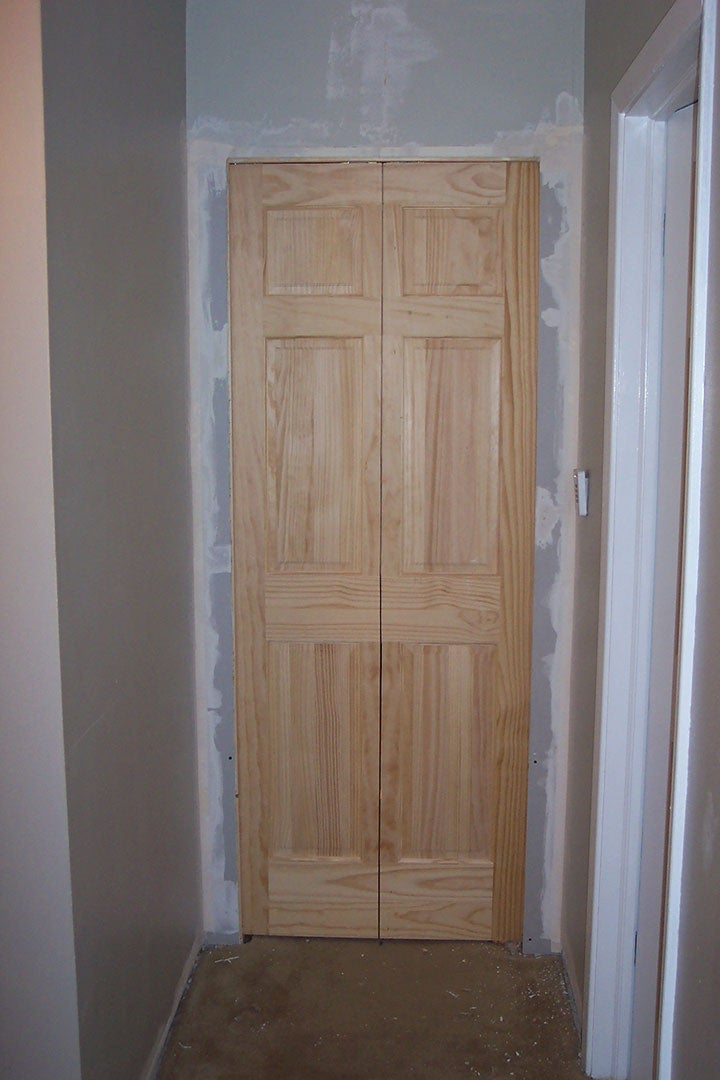 Install the Track, Hang the Doors, and Patch Up One Wall.