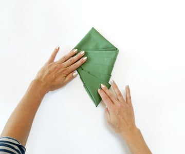 Fold Both Outer Corners to Their Opposite Sides