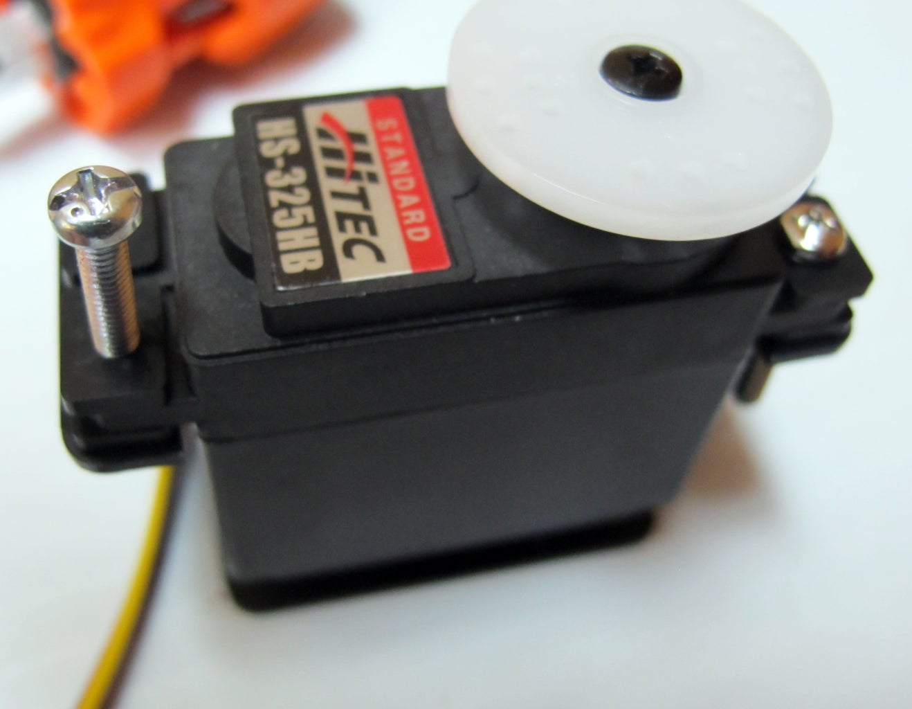 Prepare the Frame: Mount the Servos on the Brackets
