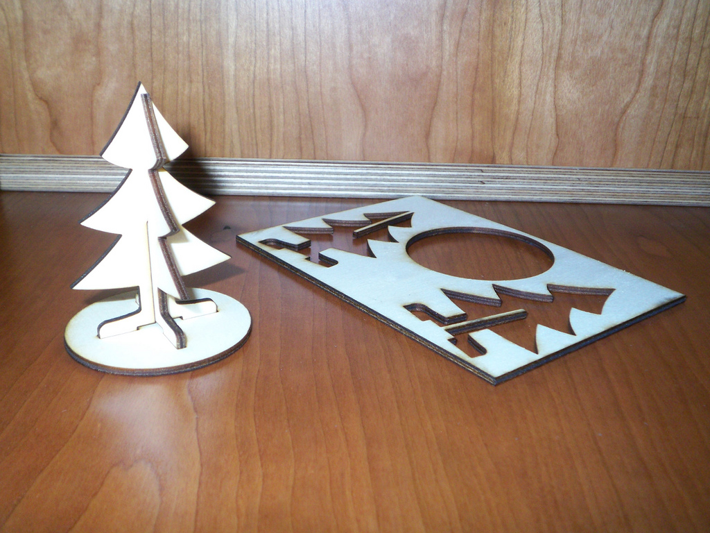 a wooden christmas tree sending in an envelope