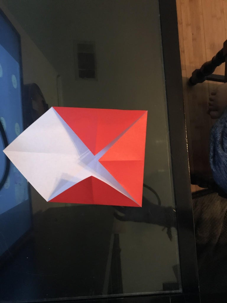 Step 6: Fold 3 of the Corners to the Center