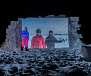 Outdoor Movie Theater With Snow Wall and Projector