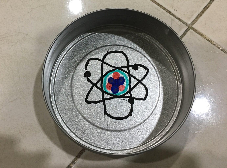 2D ATOM IN a TIN