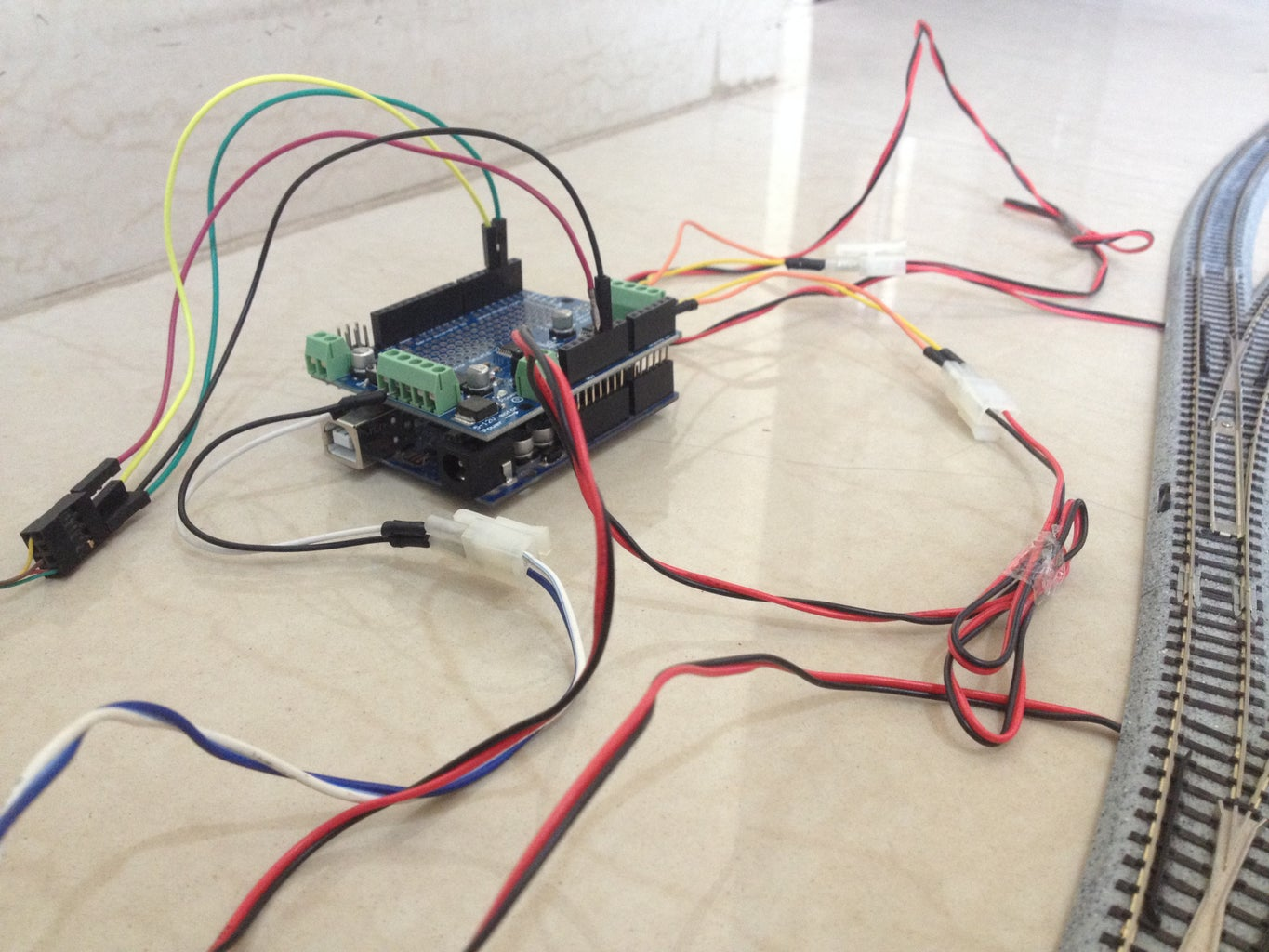 Connect the Motor Output Wires to the Turnouts and Track Power