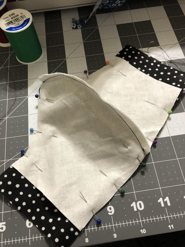 """Now Put the Fabric Together by Putting the """"right Sides"""" Together and Pin It All the Way Through. Once Pinned, Sew Along the Top and Bottom of the Mask"""
