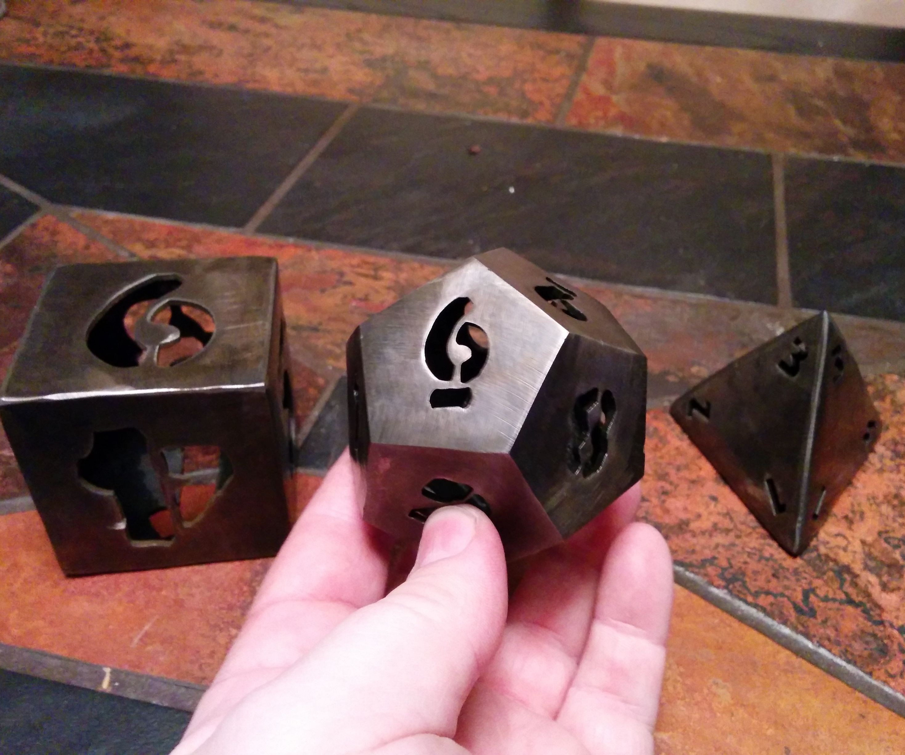 Gaming dice made from folded, waterjet cut steel
