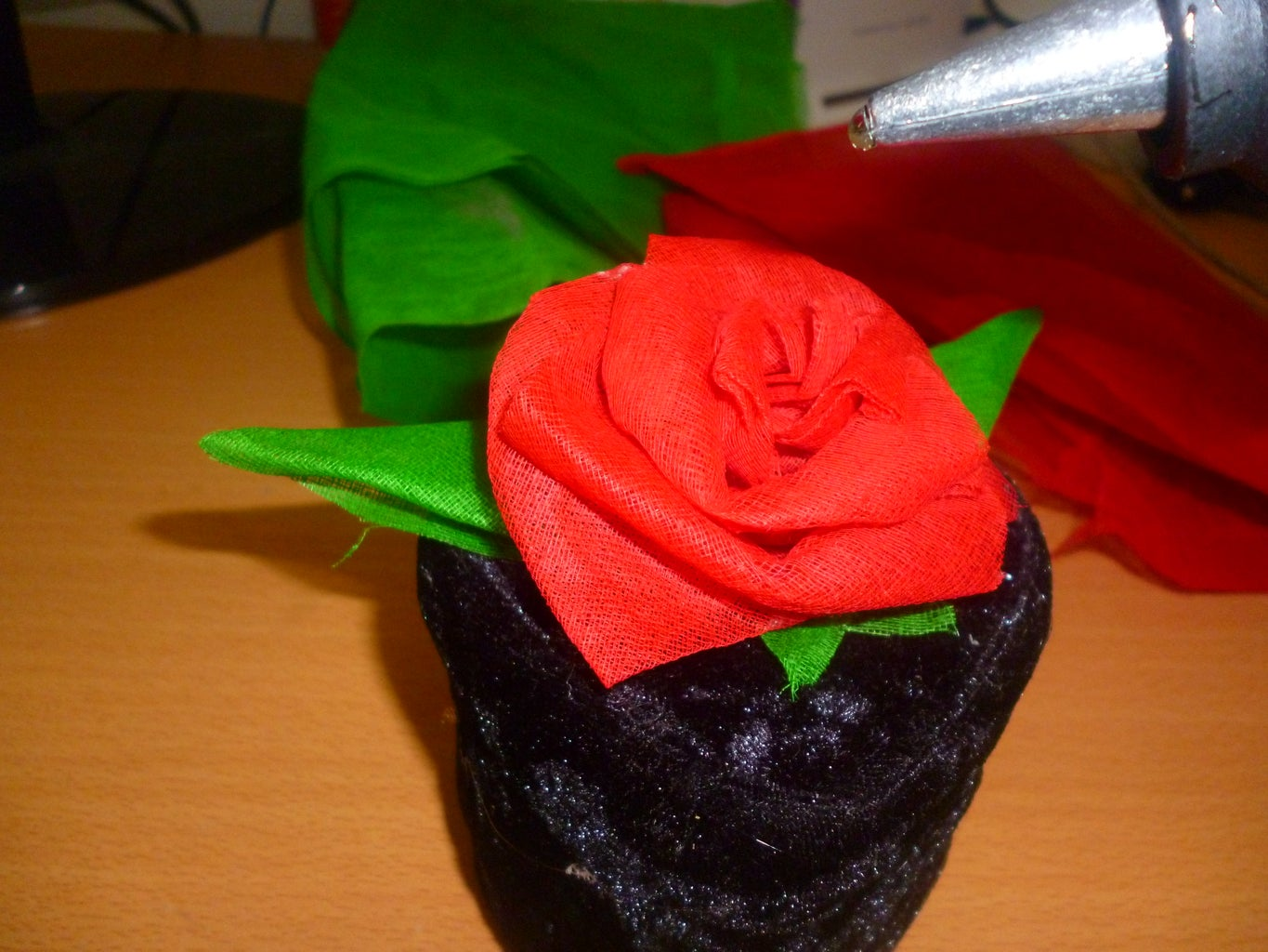 Mke Some Fabric Flowers and Leafs and Stick It With Hot Glue Gun