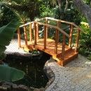 Steel frame wooden bridge