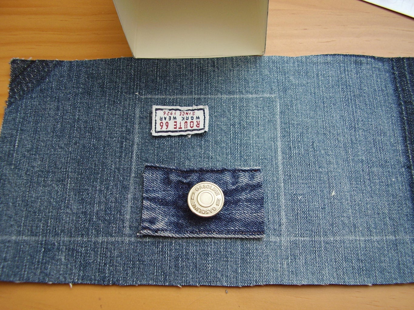 Measuring and Sewing Labels and Buttons Onto the Outside Denim Lining