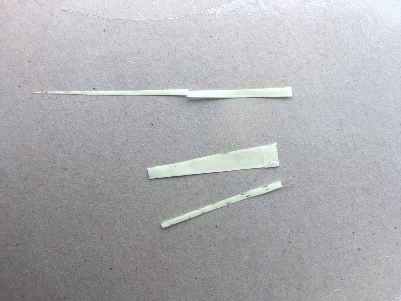 CUT RADIUM STICKER STRIPS TO HOUR AND MINUTE INDICATION