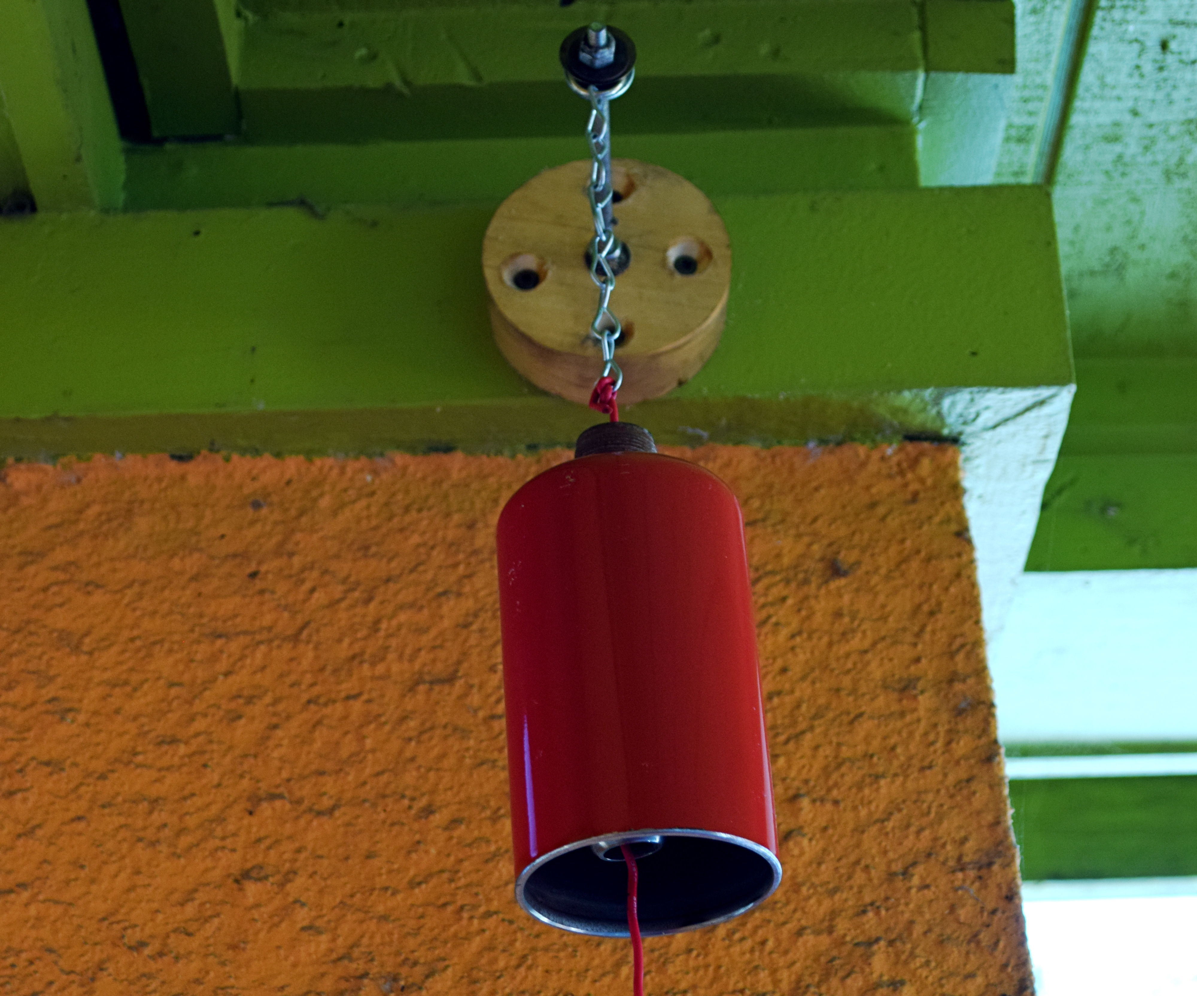 Recycled tank door bell
