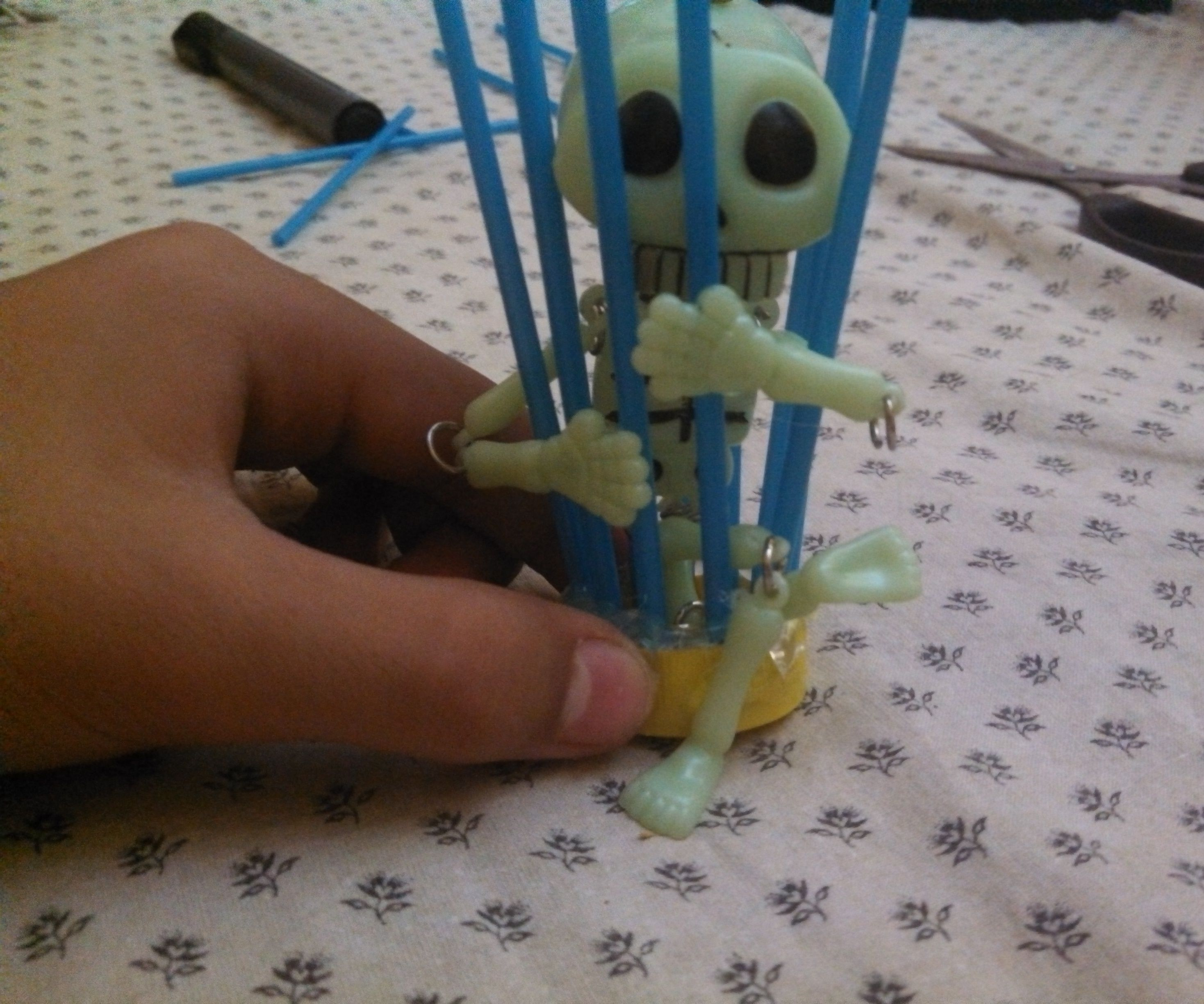 Make a skeleton in a cage décor for your fish tank ( Halloween )
