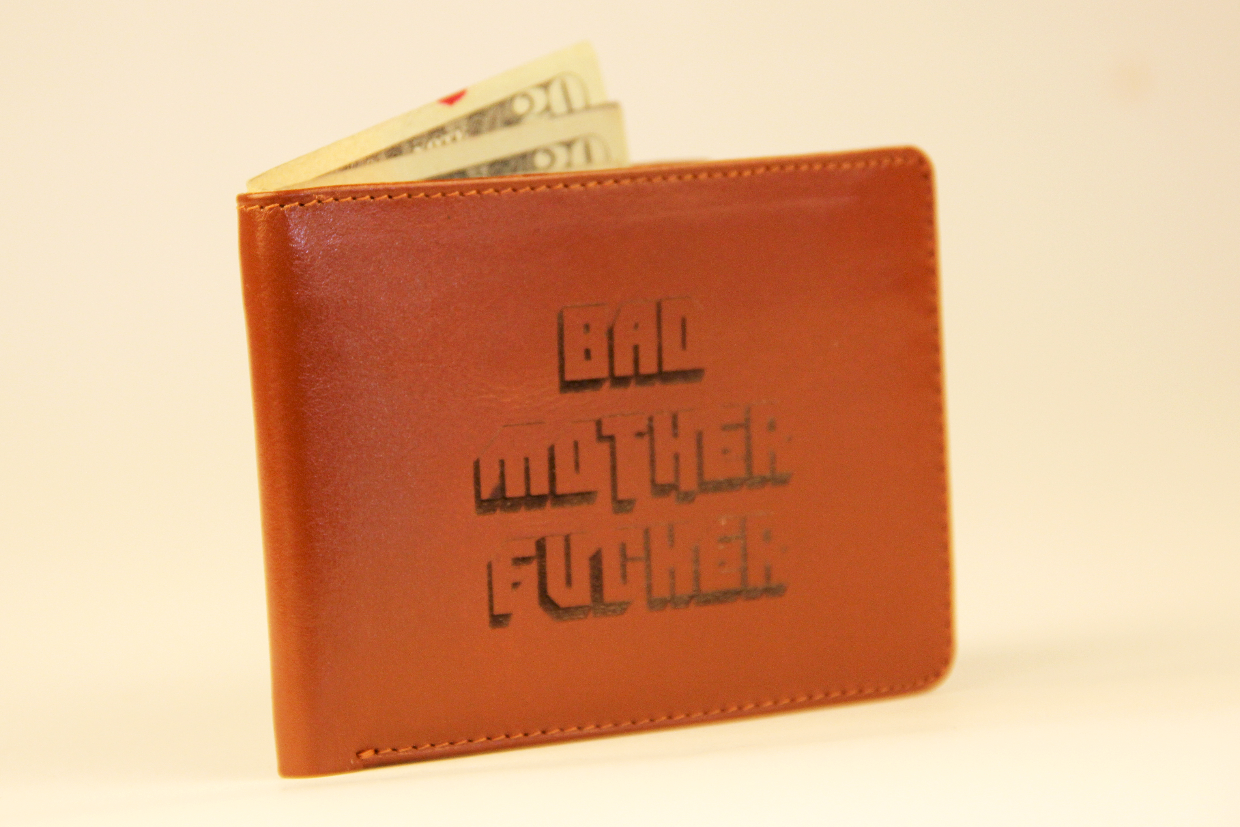 Laser etch your leather wallet and stop a robbery