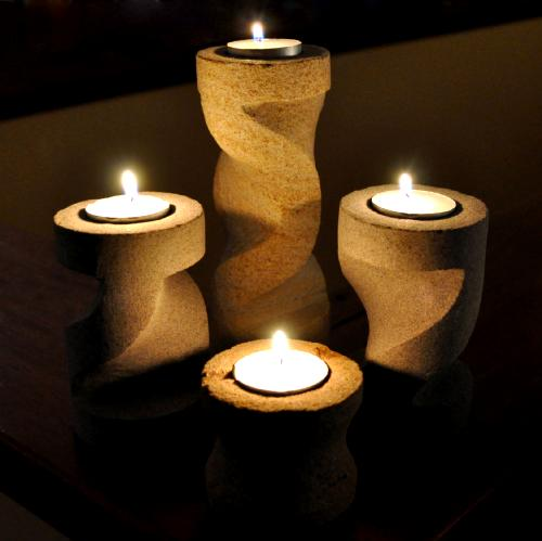 Four Piece Carved Sandstone Candle Holder Set