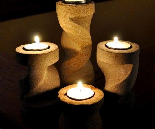 Four Piece Carved Sandstone Candle Holder Set