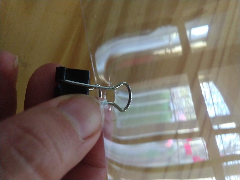 Push Binder Clip Through Each Hole