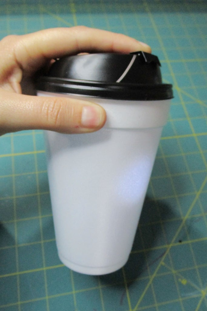 Push Down Tab, and Line Up Your Lid Tape to Those on Your Cup