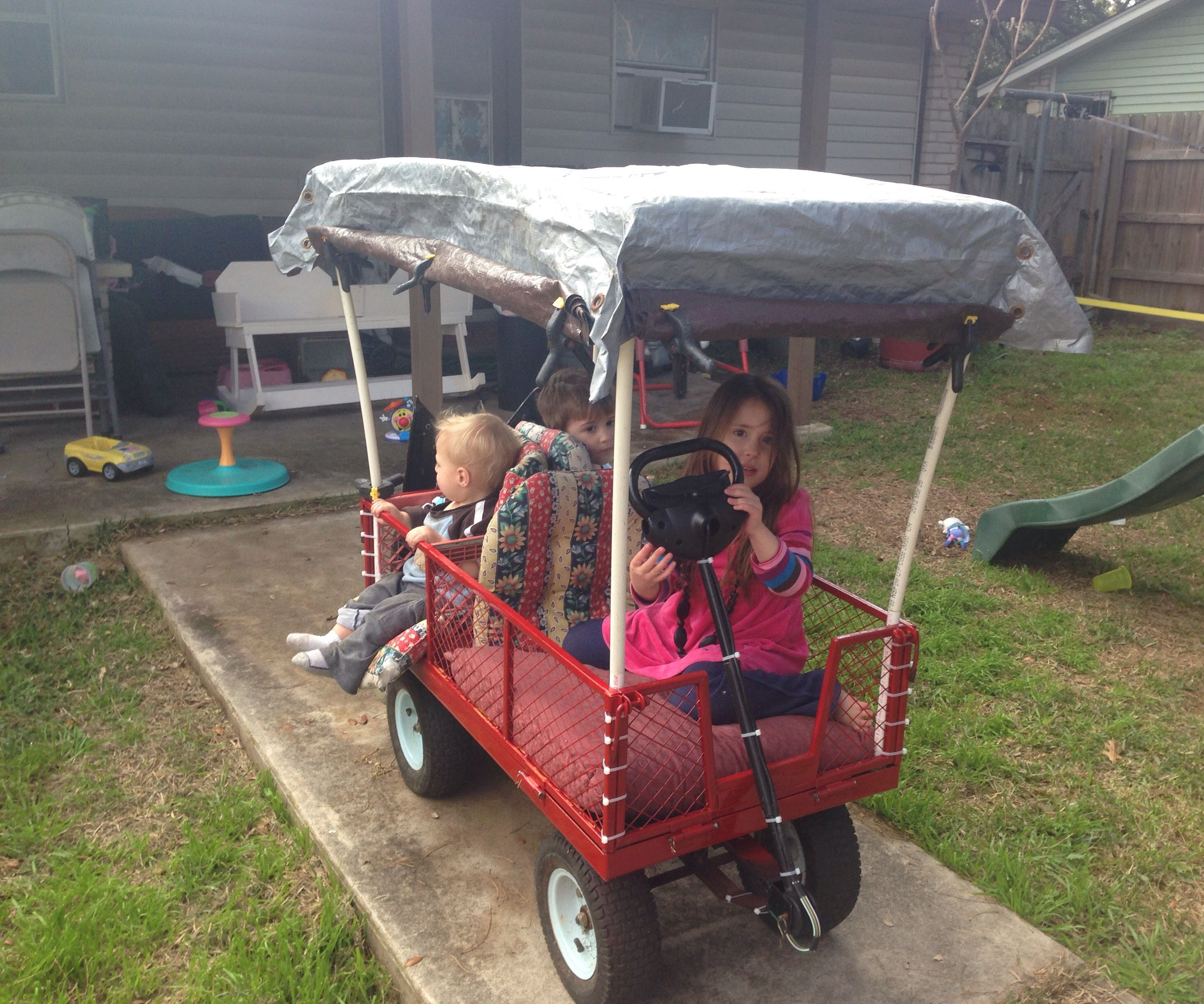 Self propelled Kiddo Chariot from old garden wagon and mobility scooter on a $100 to $200 budget.